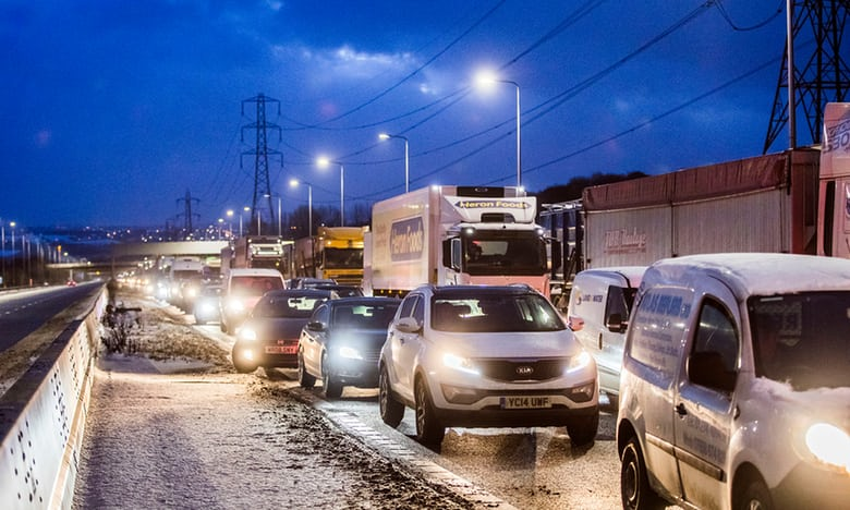 UK weather: snow disruption continues with hundreds of drivers stranded